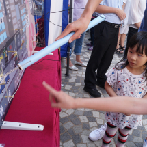 Young visitor listening to game booth explanations